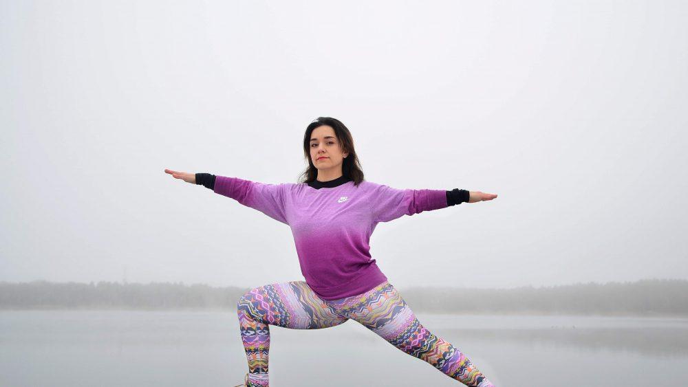 girl yoga warrior two
